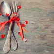 Stock Photo: Old vintage fork and spoon with red ribbon and valentine's hearts