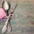Stock Photo: Old vintage fork and spoon with pink knitted valentine's heart