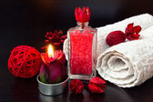 Red romantic candle and spa stuff — Stock Photo