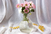 Bouquet of lovely pink flowers in vase — Stock Photo