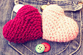 Knitted hearts on a vintage jeans pocket — Stock Photo