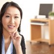 Asian woman at work - Stock Photo
