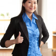 Energetic Asian professional woman - Stock Photo