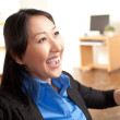 Energetic Asian professional woman — Stock Photo #12189844