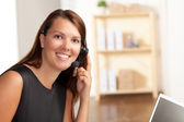 Cute lady wearing black dress at work — Stock Photo