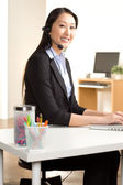 Asian woman at work — Stock Photo