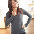 Beautiful Hispanic woman and gray shirt - Stock Photo