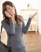 Beautiful Hispanic woman and gray shirt — Stock Photo