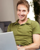 Handsome white man at home — Stockfoto