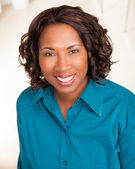 Attractive black woman with blue shirt. — Stock Photo