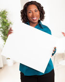 Attractive black woman with blue shirt on — Stock Photo