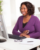 Pretty African American woman working in office — Stock Photo