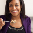 Attractive African American eating breakfast — Stock Photo #12420452