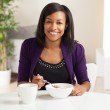 Attractive African American eating breakfast — Stock Photo #12420454