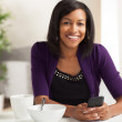 Attractive African American eating breakfast — Stock Photo #12420524