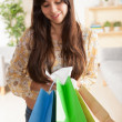 Stock Photo: Happy Hispanic shopper