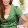 Cute girl with piggy bank — Stock Photo #12427304