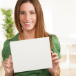 Pretty white woman holding blank sign — Stock Photo