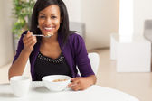 Attractive African American eating breakfast — Stock Photo