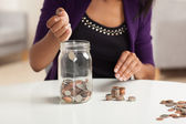 Cute young black female doing finances — ストック写真