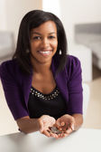 Cute young black female doing finances — Stock Photo