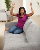 Pretty young black woman at home — Stock Photo