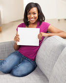 Pretty young black woman holding sign — Stock Photo