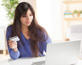 Adorable Latina woman shopping online — Stock Photo