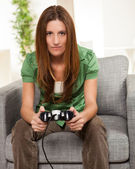 Cute female gaming at home — Stock Photo