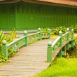 Nice old wooden bridge in park at summertime. — Foto de Stock
