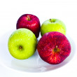 Different concepts - red apple between green apples — Stock Photo