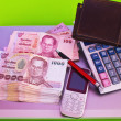 Close up of 1000 baht banknotes and calculator on note book — Stock Photo