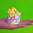 Colorful of Cupcake on women hand — Stock Photo