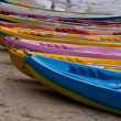 Colourful kayaks on the beach — Stock Photo