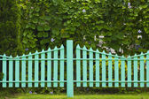 Wooden fence in the grass. — Stock Photo