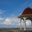 Pavilion with a view of the sea on the blue sky background. — Stock Photo
