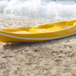 Royalty-Free Stock Photo: Single yellow kayak  on the beach.