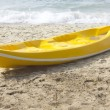 Single yellow kayak on the beach. — Stock Photo #17416423