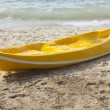Single yellow kayak on the beach. — Stock Photo