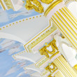 Stock Photo: Beautiful plaster cherub detail with gold leaf scallop and oak l