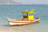 Wooden fishing boat on the beach. — Stock Photo