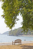 Wooden garden chair in beside the sea — Stock Photo