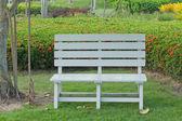 Wooden garden chair in beautiful garden — Stock Photo
