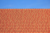 Dark brown roof against blue sky — Stock Photo