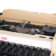 Vintage manual typewriter, with sheet of aged notepaper providin — Stock Photo