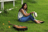 View of a beautiful young country girl with a guitar — Stock Photo