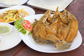Fried snapper with chili sauce on the plate — Stok fotoğraf