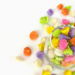 Colorful candy in glass saucer and bowl isolated on white backgr — Stock Photo #49511799