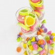 Colorful candy in glass saucer and bowl isolated on white backgr — Stock Photo #49511841
