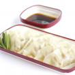 Plate of steamed dumplings with soy sauce — Stock Photo #50836311